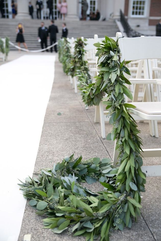 This eucalyptus garland is just gorgeous!!! So luscious! Such a fun change from having flower aisle arrangements.