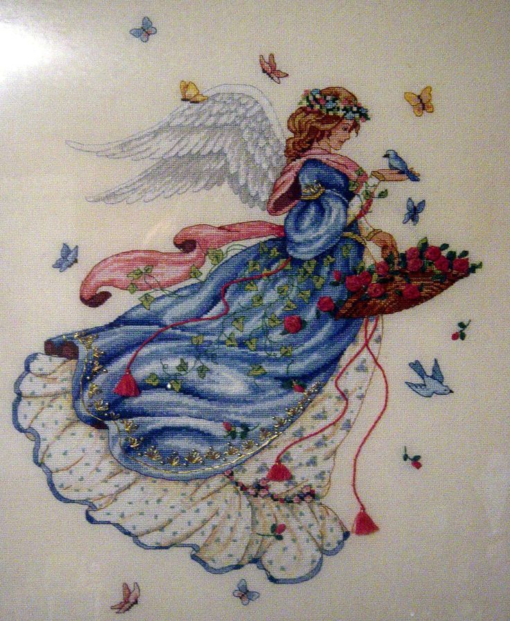 This cross-stitch angel was completed many years ago (about 8!) and she hangs in my daughter's bedroom now. Dimensions Gold Collection Kit, but I'm not sure what it's called is or wh...