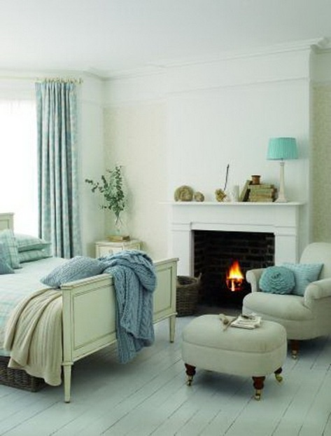 possible way to arrange bed with the fireplace and a reading chair.