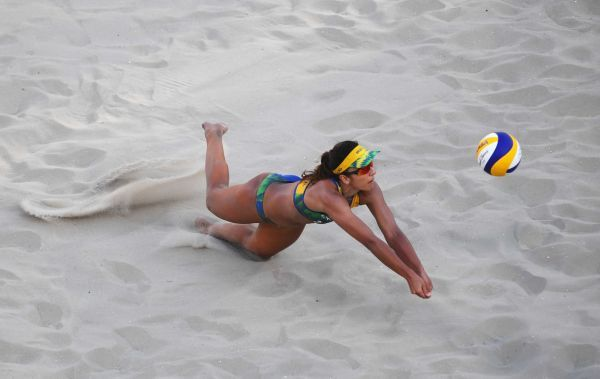 Barbara Seixas de Freitas of Brazil dives for the ball during the Women's Beach Volleyball preliminary round Pool B match against Barbora Hermannova and Marketa Slukova of the Czech Republic on Day 1 of the Rio 2016 Olympic Games at the Beach Volleyball Arena on August 6, 2016 in Rio de Janeiro, Brazil.