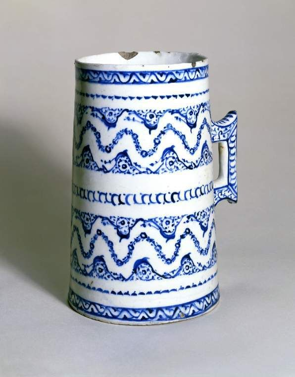 Maker:    Unknown; potter    Category:    fritware (stonepaste)    Name(s):    tankard  Islamic pottery; category  Iznik; category    Date:    circa 1540 — circa 1550    School/Style:    Ottoman    Period:    mid 16th century