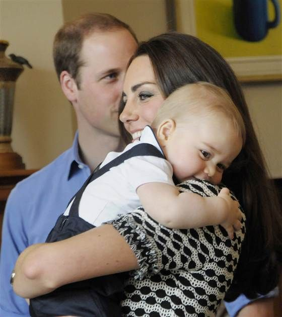 This handout photo taken on April 9, 2014 and provided by Woolf / Crown Copyright shows Britain's Prince George being held by his mother