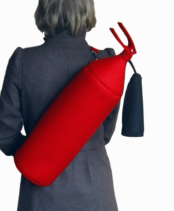 You might not really want this babe. But this Fire Extinguisher Bag is Smokin' Hot