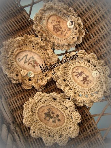 crochet-framed cross-stitch brooches
