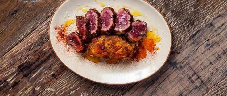 This recipe for Ibérico pork fillet with trintxat potatoes comes from Lobos tapas bar in Borough market. Lobos uses Ibérico pork, which is darker in colour and can be eaten rare. If you're using regular pork, transfer to the oven and roast until cooked throughout.