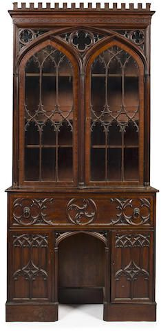 An English Gothic revival carved mahogany secretary bookcase fourth-quarter 19th century