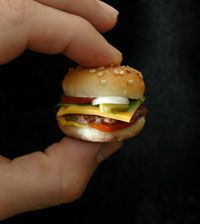 That is an actual, edible burger.  It's less than two inches all around!