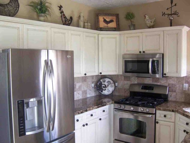 New white kitchen cabinets with black stainless steel appliances at temasistemi.net