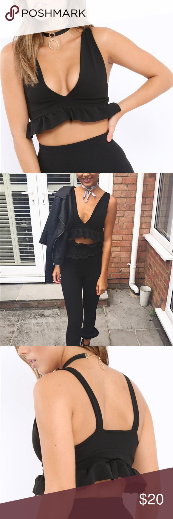 *NEW* Black Frill Hem Crop Top Brand new Without Tags. Look fab in frills this summer in the Keya Black Frill Hem Crop Top! Featuring plunge neckline and a frill hem. Wear with denim shorts and some wedges for the ultimate summer nights look. Size UK 6, so it's an XS. Missguided Tops