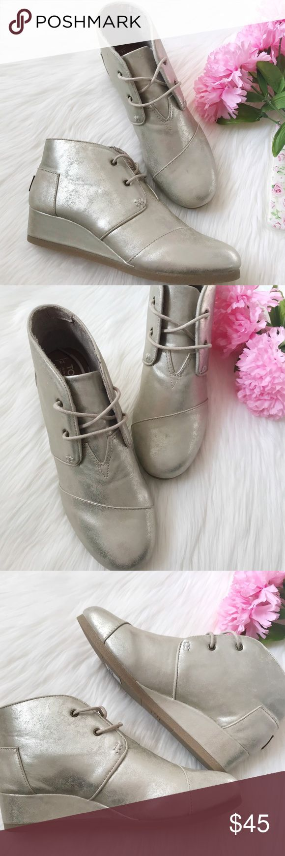 Toms Metallic Wedge Booties Toms Metallic wedge booties  Ankle bootie Cord laces with metal tips  New without box  Size 6 Toms Shoes Ankle Boots & Booties