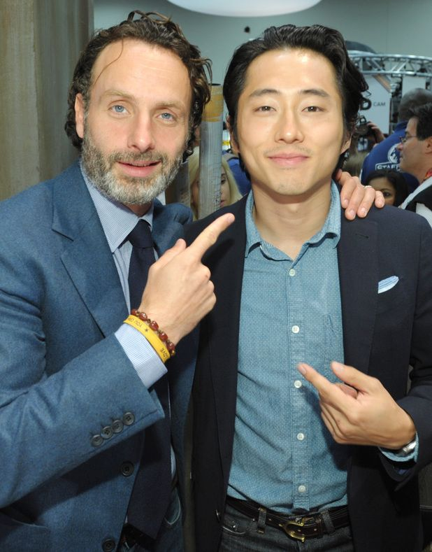Andrew Lincoln and Steven Yeun attend AMC's The Walking Dead booth signing @ SDCC 2013