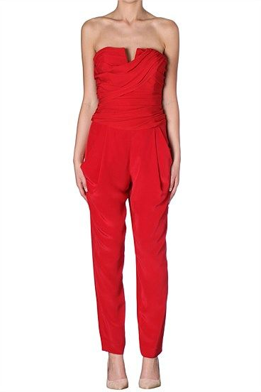 ROUGE SILK DRAPED BUSTIER JUMPSUIT A refreshing change for after hours wear is the jumpsuit and this season's strapless number is perfect for any occasion. With a fitted boned bodice and loose pants pair with flat sandals for a weekend lunch, then change to heels for the night out.