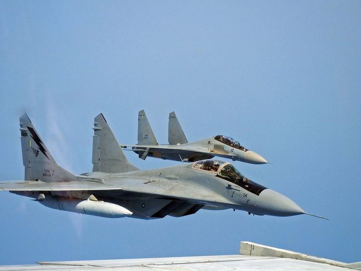 Air-to-Air Images of Mig-29N Fulcrum and Su-30 Flanker jets....taken from U.S. Super Hornet