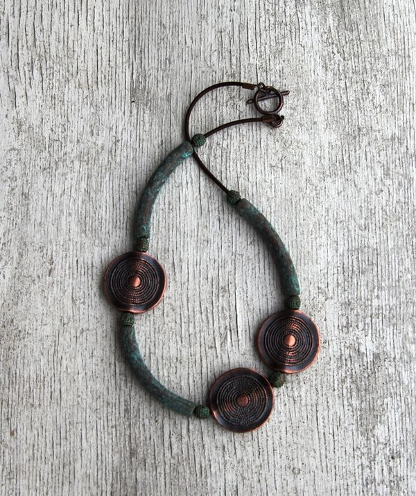Copper with green patina.