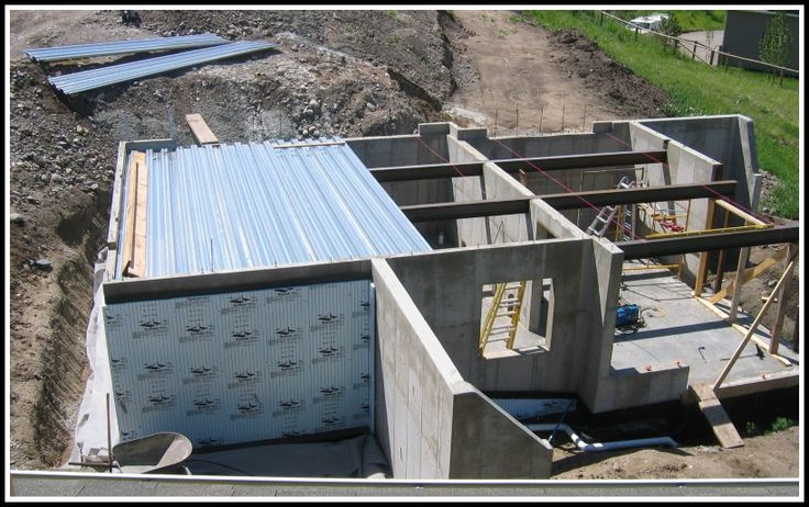 Corrugated steel supported poured concrete garage floor for Pouring a basement