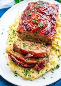 Bacon Wrapped Meatloaf!  This Bacon wrapped meatloaf will become a family favorite for sure! Meatloaf is back and better than ever, full of flavor, some hidden veggies, and wrapped with delicious thick cut Bacon!