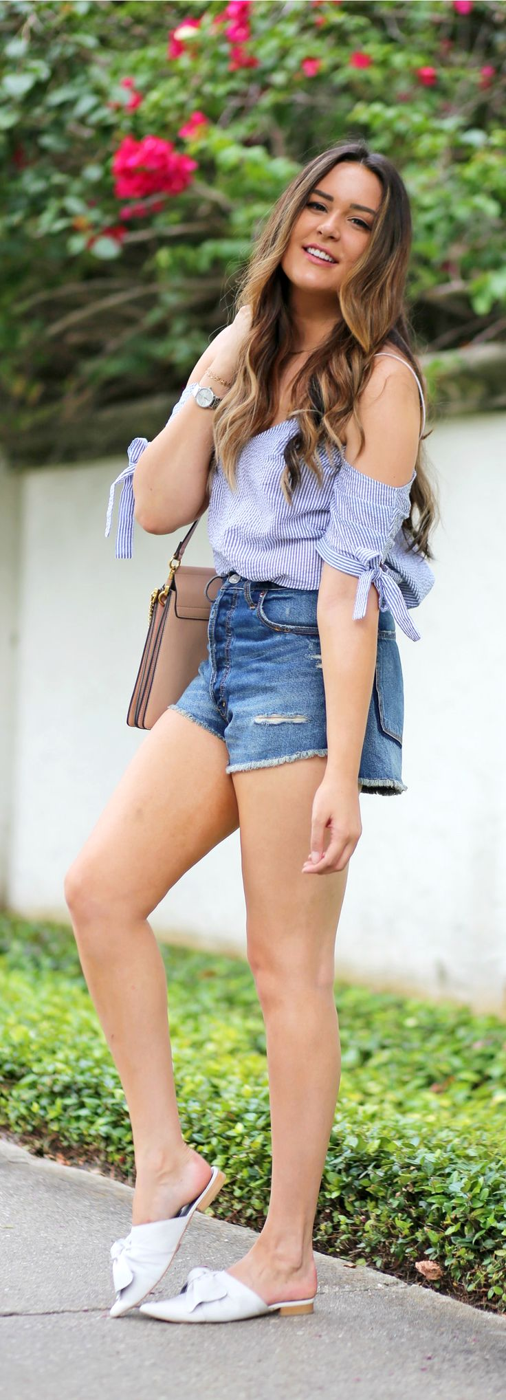 Adorable! | Fashion blogger Mash Elle styles a blue striped seersucker off the shoulder top from Urban Outfitters  with high waisted cut off ripped jeans short from Abercrombie and Fitch shorts, Michael Hill watch, and Chloe Faye purse.