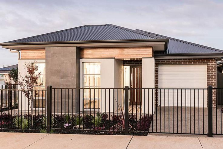 This stunning facade is a true delight on any street. #weeksbuildinggroup #newhome #homedesign