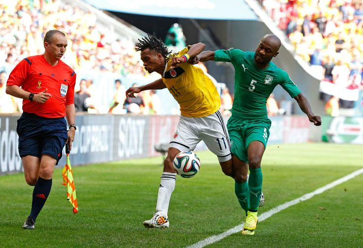 BRASILIA, BRAZIL - JUNE 19: Didier Zokora of the Ivory Coast competes for the ball with Juan Guillermo Cuadrado of Colombia during the 2014 FIFA World Cup Brazil Group C match between Colombia and Cote D'Ivoire at Estadio Nacional on June 19, 2014 in Brasilia, Brazil. (Photo by Gabriel Rossi/Getty Images)