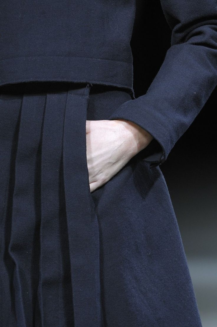 Yohji Yamamoto. There is definitely a certain mood that prompts one to put one's hand in a pocket. The tucked in mood--especially with austere color of the suit, and the woolen density. The hand in the pocket also feels like a secret.