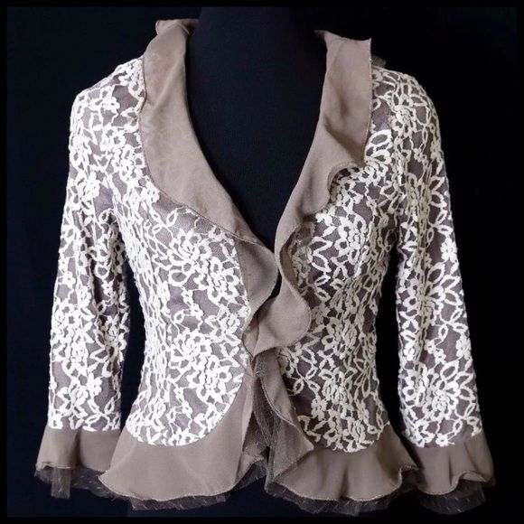 """Ruffle Lace Beige Ivory Gold Cardigan Jacket ‼️PRICE FIRM‼️  Small  SIMPLY BEAUTIFUL!!!  Layers of tulle & lace make this an absolutely beautiful piece that can go from the office to a dinner party effortlessly.  And it is perfect for year round wear!  Fully lined.  It would look amazing with layers of pearls! Lots and lots of stretch for a perfect & comfortable fit! Self: 90% nylon, 10% spandex.  Contrast: 100% polyester.  Armpit to armpit 33""""-36""""  Shoulders 18""""-21""""  Waist 26""""-32""""   Length…"""