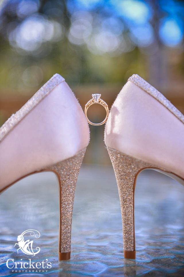 Wedding rings inbetween shoes. www.cricketsphoto.com Cricket's Photography #weddingrings  Orlando Wedding Photographer / Destination Wedding Photographer
