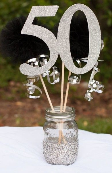 Use a mason jar to make this sparkly centerpiece for a milestone 50th birthday centerpiece.