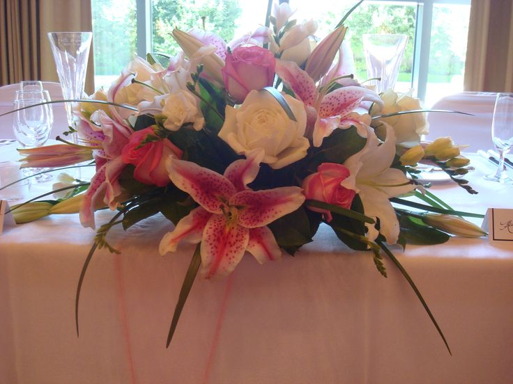 Decorate a table with an elegant arrangement.  #Flowers #Weddings