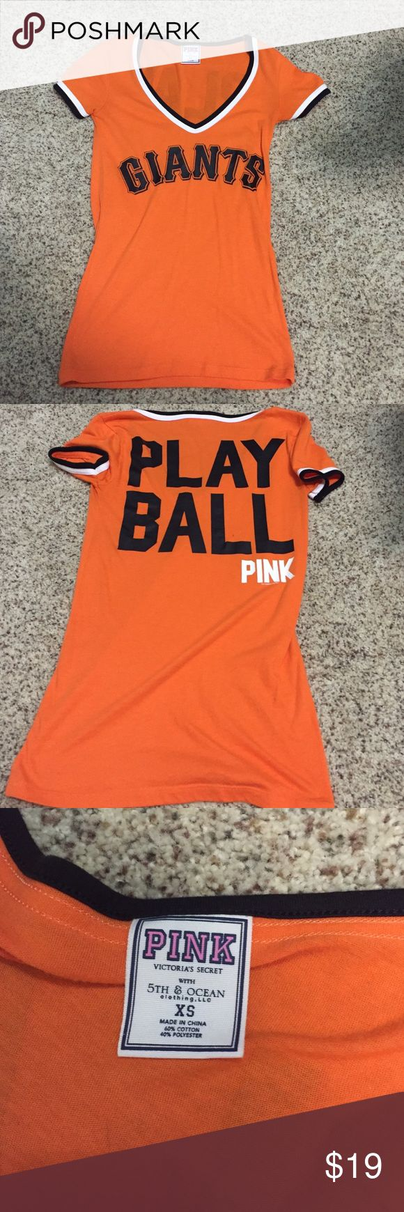 """Victoria Secret baseball tee Orange Giants baseball tee with """"play ball"""" on the back. V-neck, size xsmall. Orange tee, black letters, cap sleeve. Worn maybe 5 times to a little league baseball game. Excellent condition PINK Victoria's Secret Tops Tees - Short Sleeve"""