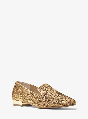 Glamorous metallic brocade highlights our Roxanne loafers. This luxe yet louche silhouette is crafted with a gilded low heel and softly rounded toe. Let them lend rich personality to trousers and denim.