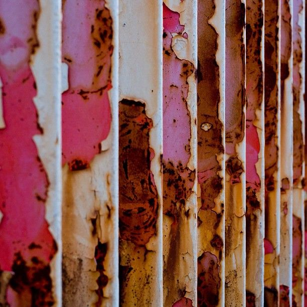 pink paint on corrugated panel