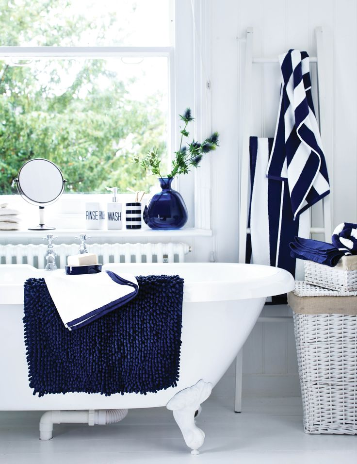An all white bathroom can easily be transformed into a for Navy and white bathroom accessories