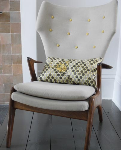 Great grey mid century armchair with yellow contrast button detail - such a lovely colour combination.