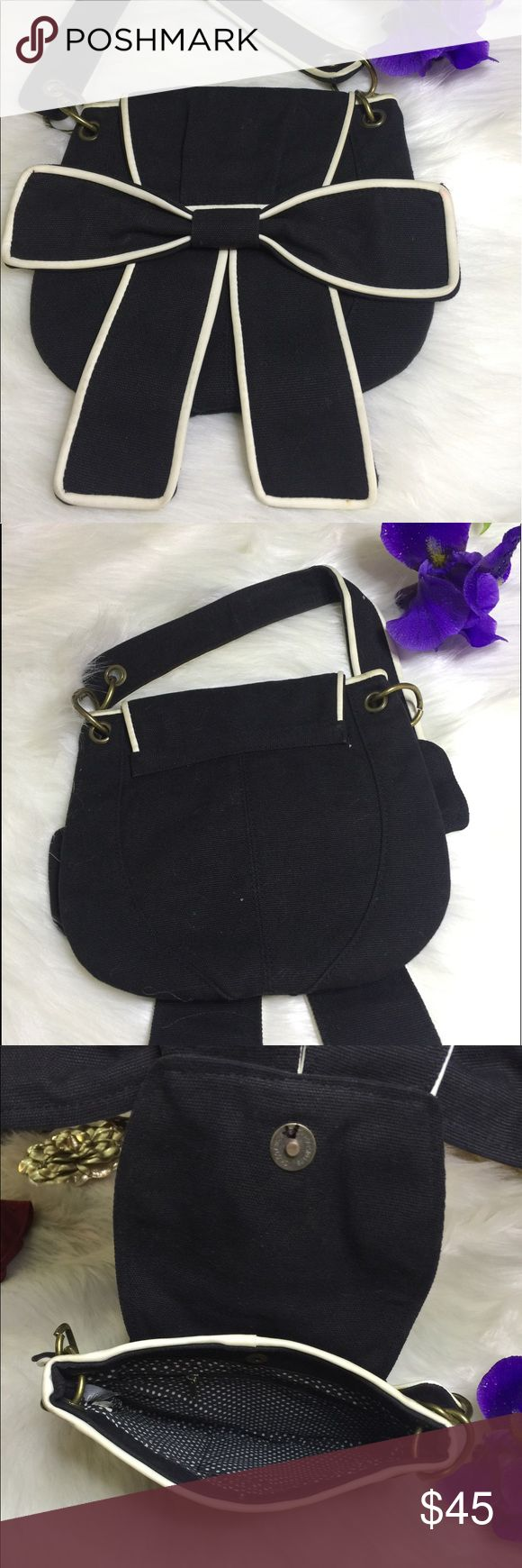 """Beautiful Black Bow Shoulder Bag - White Piping Beautiful black Bow Front shoulder bag with white piping with polka dot lining  Fantastic condition perfect for any occasion this is just the cutest purse ever.  Canvas exterior,  zipper pocket. Dimensions: 5"""" drop from handles. 7"""" wide, 7"""" tall. Got so many compliments when I used to carry this. Delia's Bags Shoulder Bags"""