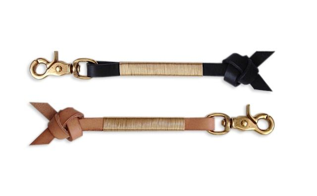"""ITEM: keychainMATERIALS: leather, brass retractable swivel hook, non-tarnish wireSIZE: 8"""" long, 1/2"""" wide (excluding knot). As each keychain is handmade, lengths may slightly vary.•handmade in Los Angeles•shipping to US only at checkout•please inquire for international shipping rates•contact for any additional information(keys not included)"""