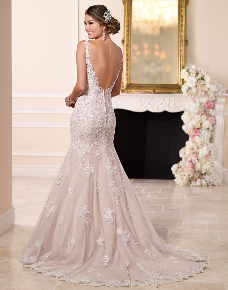 6067 // Imagined and handcrafted with simple, yet stunning detail, this feminine fit-and-flare wedding dress from the Stella York bridal gown collection features crystal beaded lace shoulder straps that give way to a plunging neckline and sexy low back.