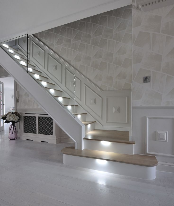 An ultra-modern staircase in light oak with LED lights installed under the  treads to