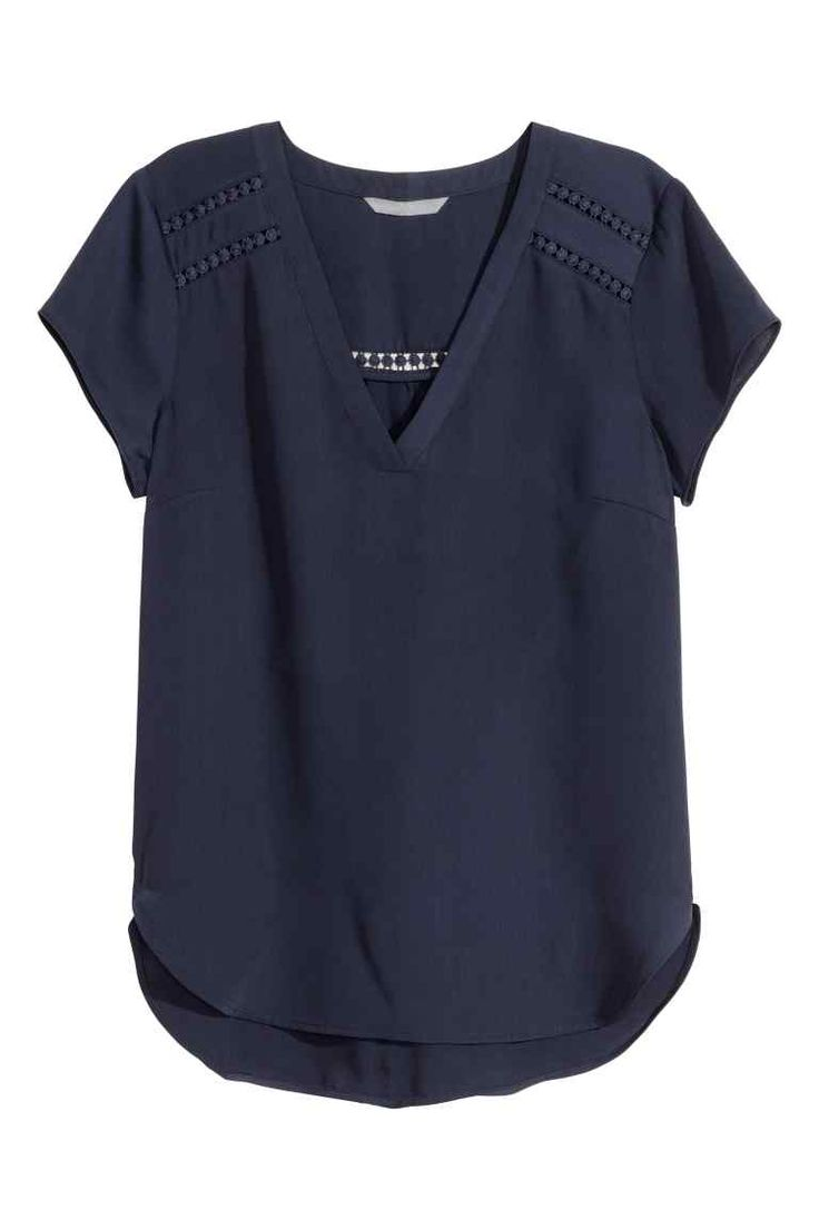 Short-sleeved blouse: Short-sleeved V-neck blouse in an airy weave with inset lace trims and a gently rounded hem that is slightly longer at the back.