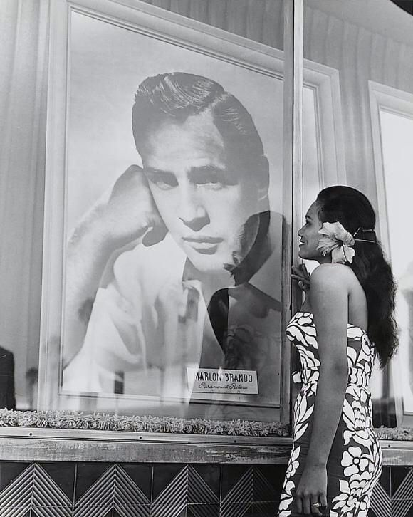 """Tarita looking at picture of Marlon Brando while filming """"Mutiny On The Bounty"""" (1962)"""