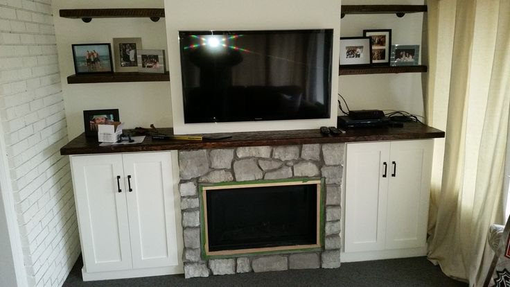 Gorgeous fireplace with shelving. Entertainment area.
