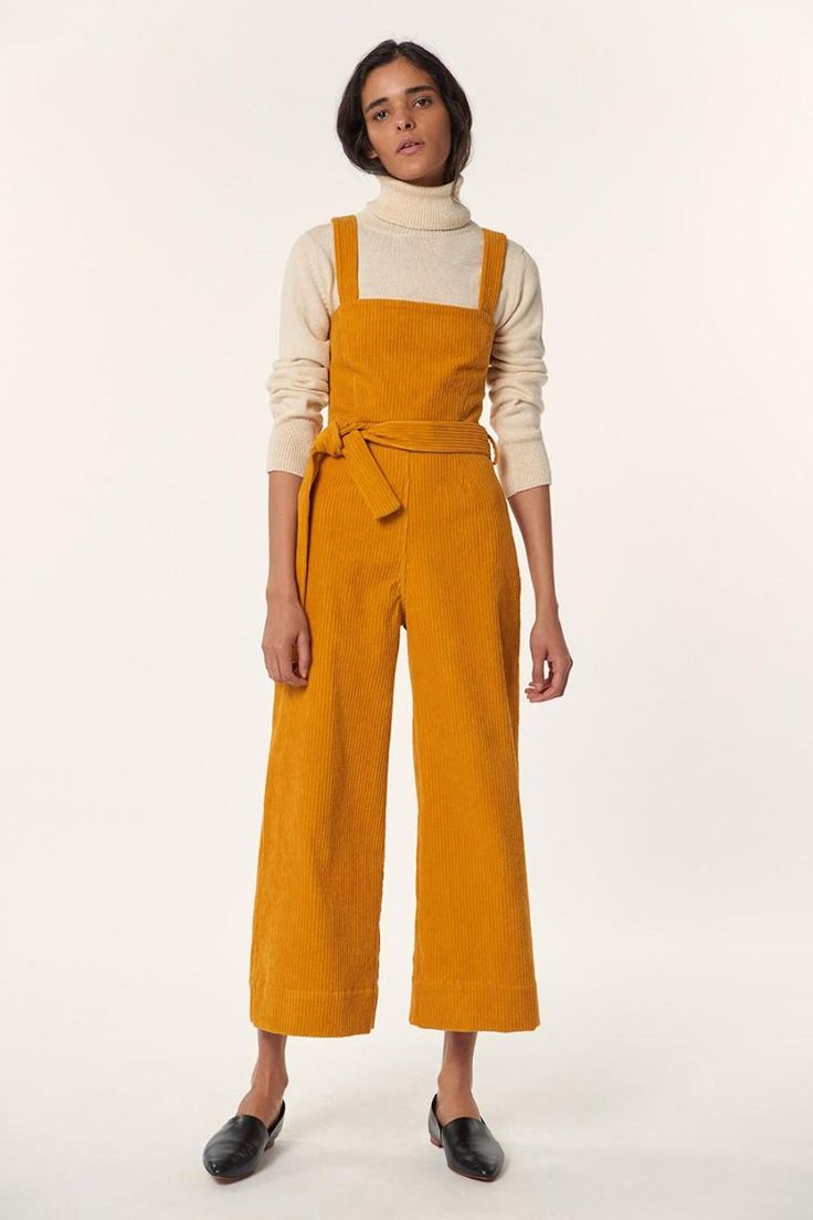 The Idola is an organic cotton corduroy jumpsuit in mustard. It's comfortable yet stylish and very indicative of Mara's personal style. Perfect for layering in the winter then dressing down with in the summer.