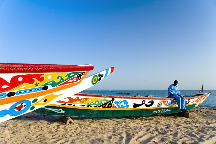 Colorsful traditional fisheermen's boats on a beach in Dakar.