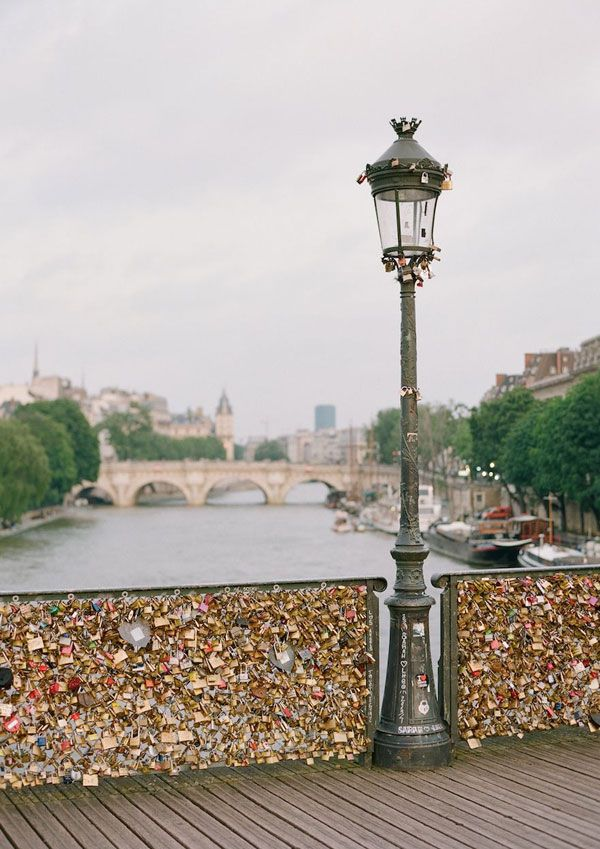 sight seeing... The Pont des Arts bridge in Paris where lovers leave a padlock with their names and throw the key in the Seine