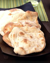 homemade pita bread... I had some leftover pizza dough that I just rolled out, let rise for a minute, and stuck in the oven on the stone...good intro for the kids to ethnic foods