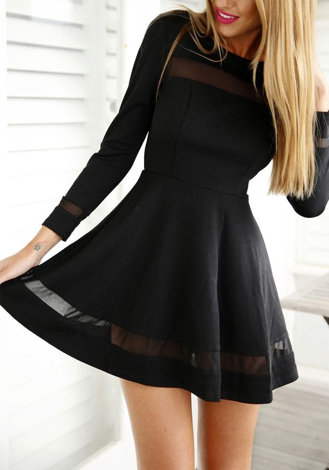 Blonde wearing a black mesh panel skater dress