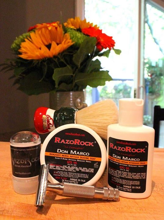 "Michael SouthernItalianbarber.com Vacation Day 7 SOTD:  - ItalianBarber.com Limited Edition 2012 Semogue Brush - RazoRock La Famiglia Shaving Soap, ""Don Marco"" Bergamot Neroli  - RazoRock ""SLAB"" three-piece safety razor - RazoRock Alum Stick - RazoRock La Famiglia Aftershave Balm, Don Marco Bergamot Neroli  Today's shave enjoyed especially for ""The Italian Barber"" himself. So many RazoRock products to choose from and enjoy; Don Marco being one of my favourites. It smells like orange…"
