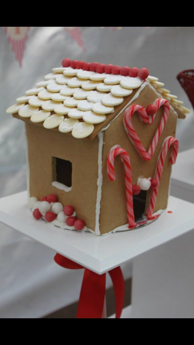 Gingerbread house, decorated with red and white - I used upside down white chocolate melts to Create a tiled roof effect.