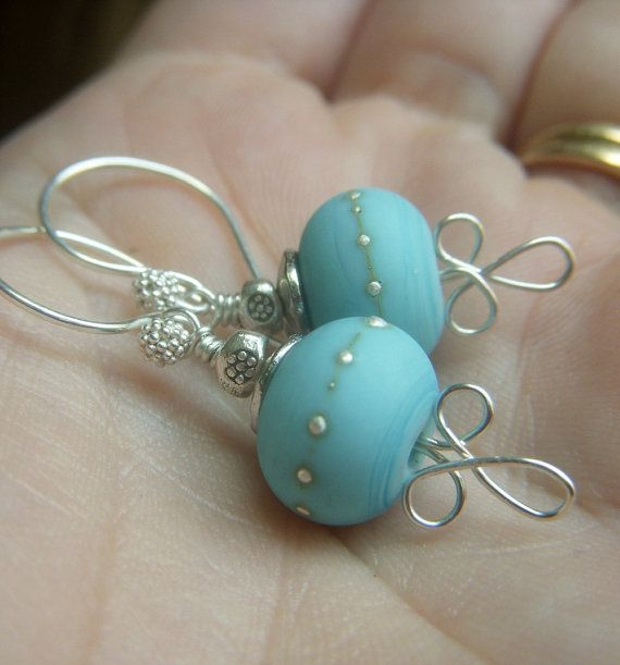 Earrings with wig jig loops for stoppers