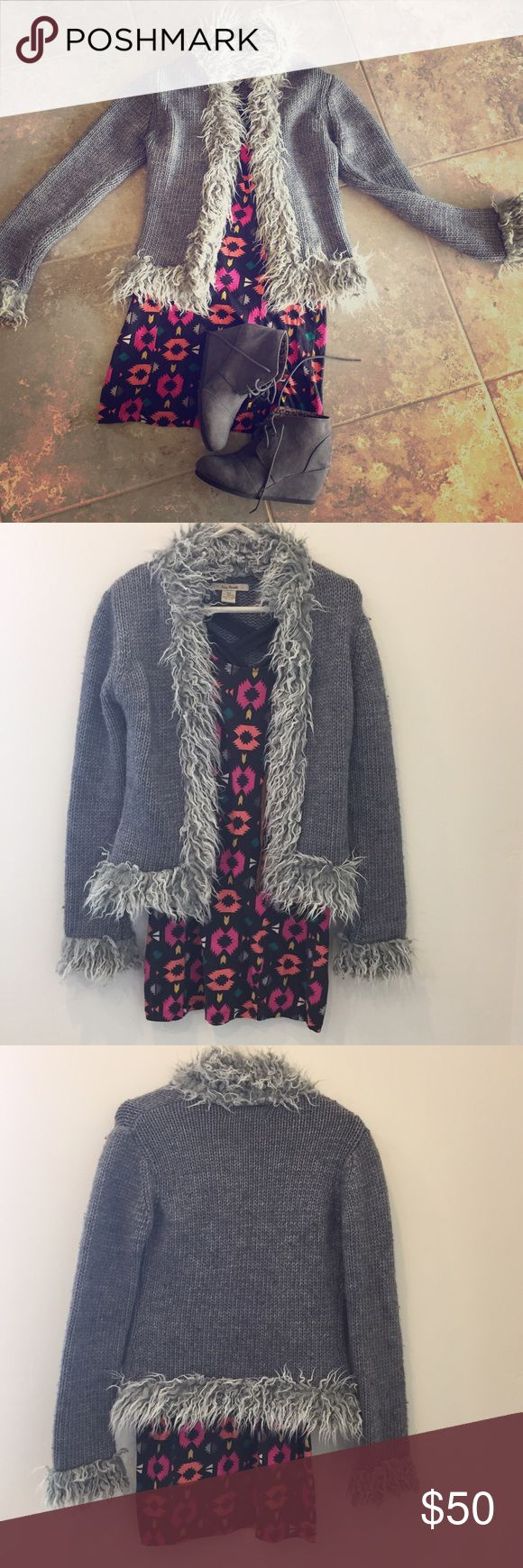 Free people gray cardigan with fur, size small Gently used free people gray cardigan with fur, size small. 50% Acrylic, 50% wool. Dress also for sale in my closet :) Free People Sweaters Cardigans