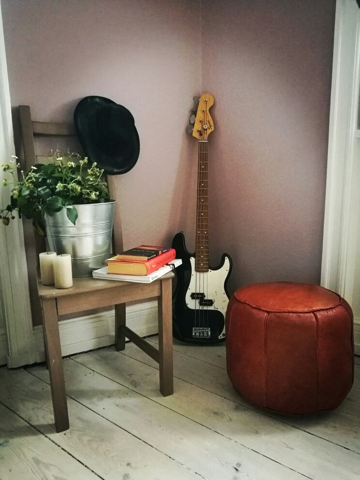 A moroccan pouf and a bass guitar.